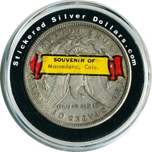 Morgan Silver dollar with Souvenir Of Massadona Colo. sticker.